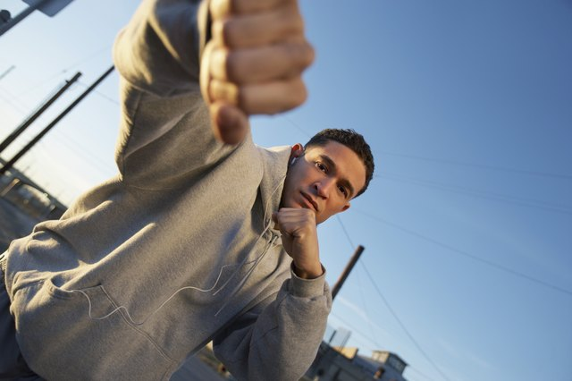 Portrait of man in fighting stance outdoors