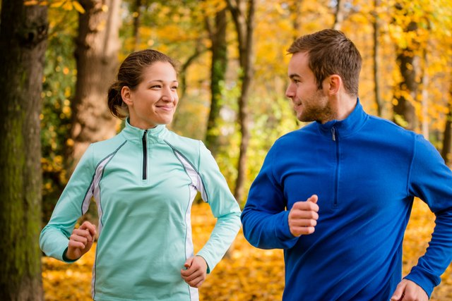 Young people jogging together in nature