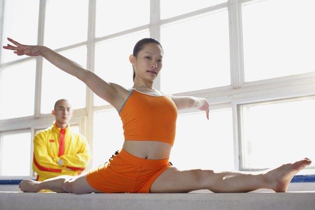 Young Woman Doing Splits on Balance Beam