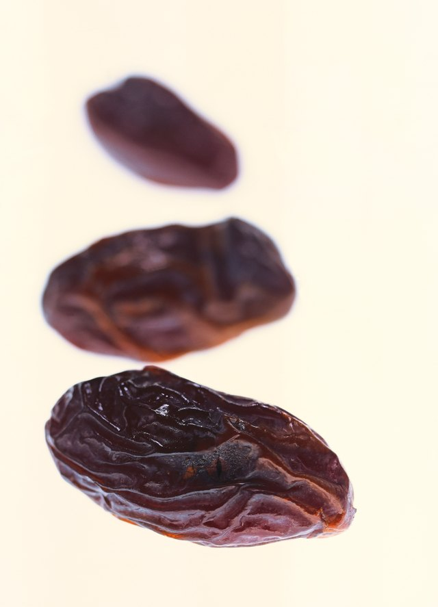 close-up of three dried prunes