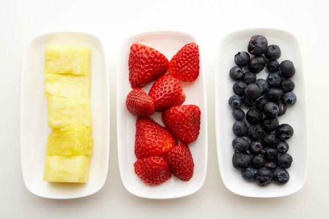 Variety of fresh fruit on plates