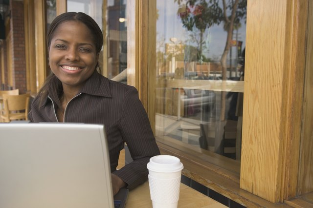 African businesswoman with laptop at cafe