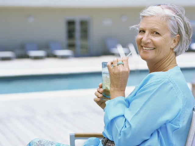 Profile of a senior woman sitting by swimming pool