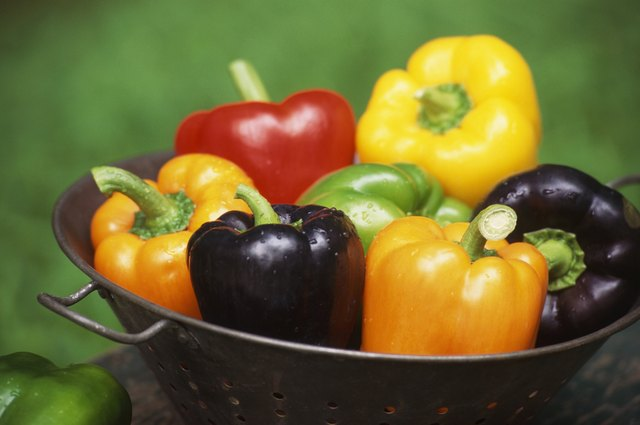 Still life of bell peppers in colander