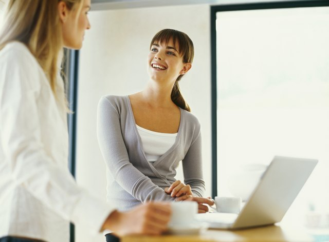 low angle view of two businesswomen talking in an office