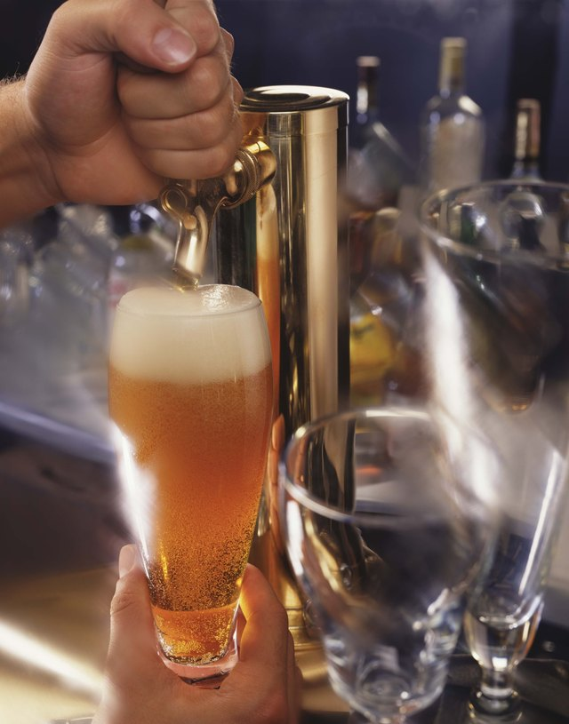 Person pouring beer