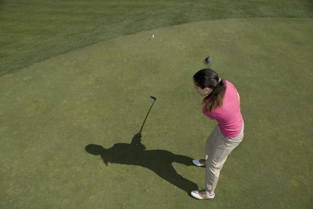 High angle view of a young woman playing golf