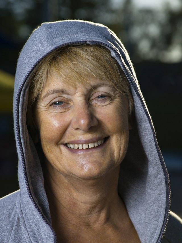 Portrait of smiling woman in hooded sweatshirt