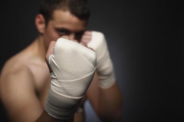 Man boxer with taped hands