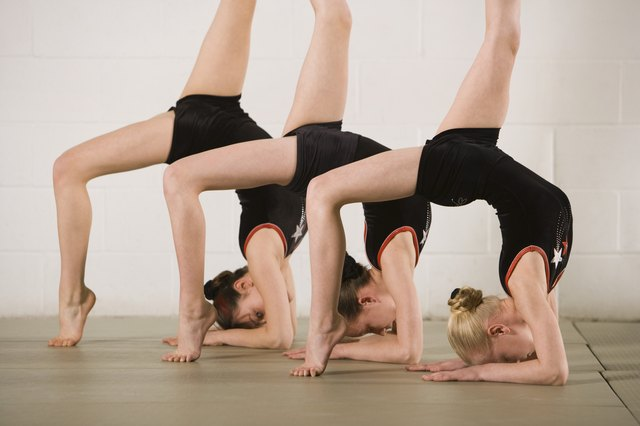 Gymnasts posing upside down