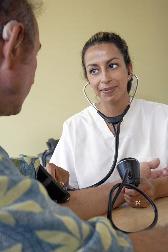 Close-up of a female doctor examining a patient