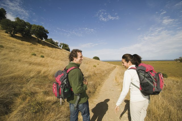 Rear view of couple laughing and hiking