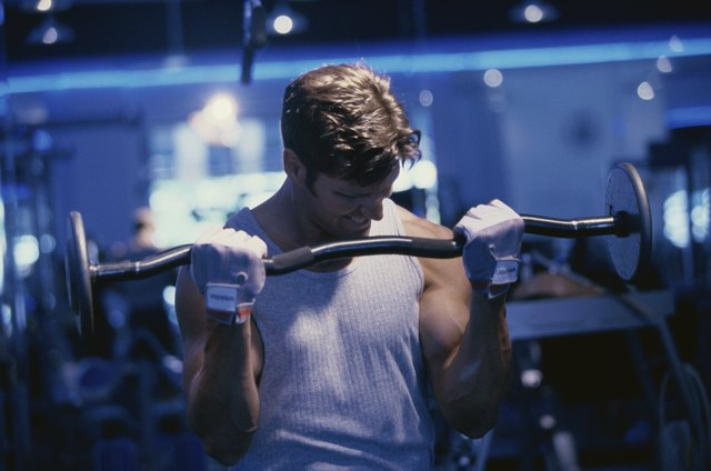 Young man exercising with barbells