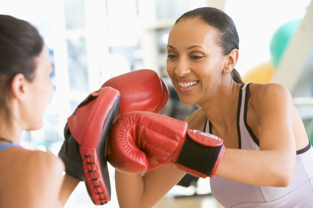 Women Boxing Together At Gym