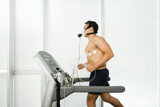 Man wearing medical testing equipment on a treadmill