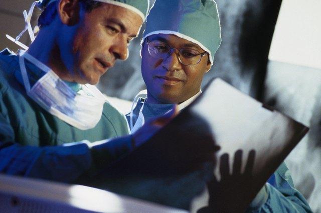 Surgeons reading x-rays