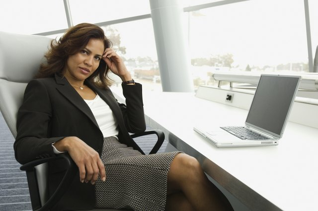 Hispanic businesswoman next to laptop
