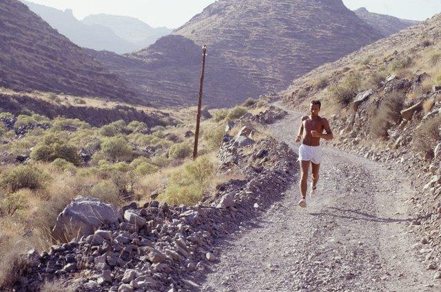 Man jogging down mountain track