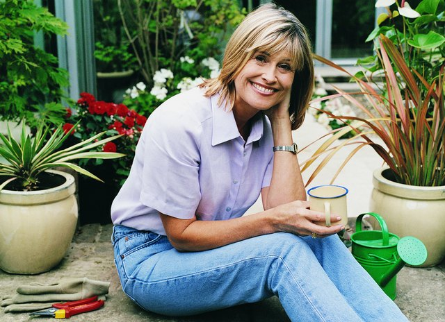 Portrait of a Woman Relaxing From Gardening With a Cup of Tea