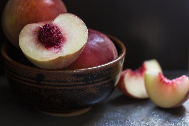 Fresh peaches and nectarines on a dark background