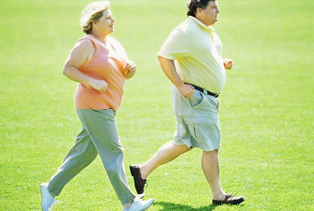 side profile of a mature couple jogging in the park