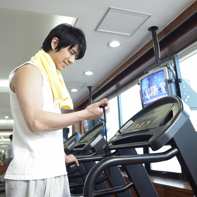 a running man on a running machine at a fitness club