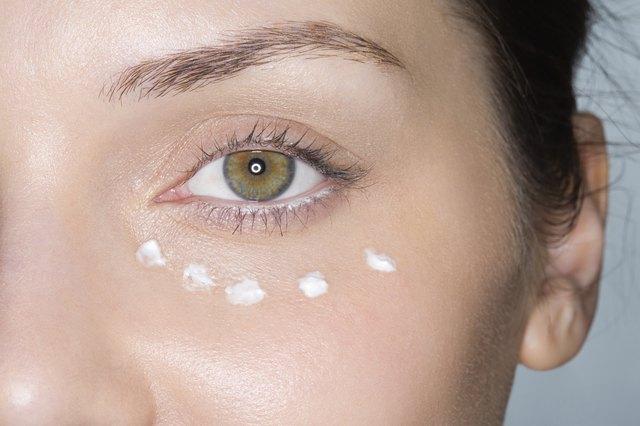 Dots of moisturiser on womans face