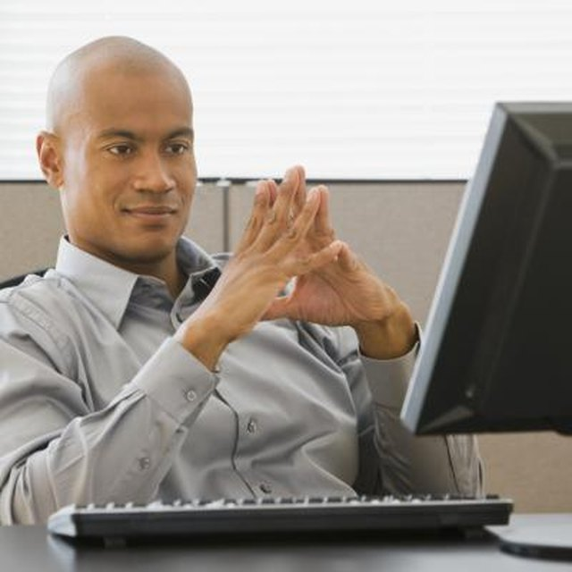 African businessman looking at computer