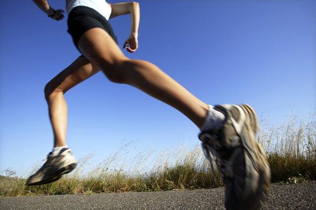 Woman jogging on road,  California,  USA