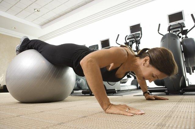 Woman doing pushups on exercise ball