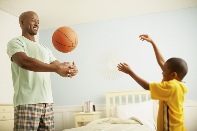 Father and Son Practicing Basketball