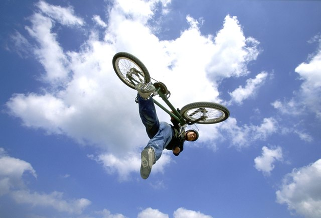 Young man performing stunt on bicycle