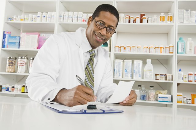 Male pharmactist working in pharmacy