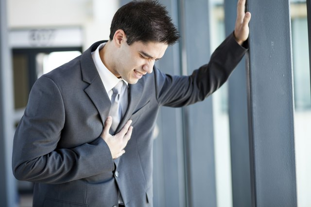 young businessman having heart attack