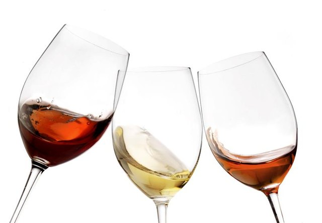 Toasting gesture red and white wine with splash, cheers close-up isolated
