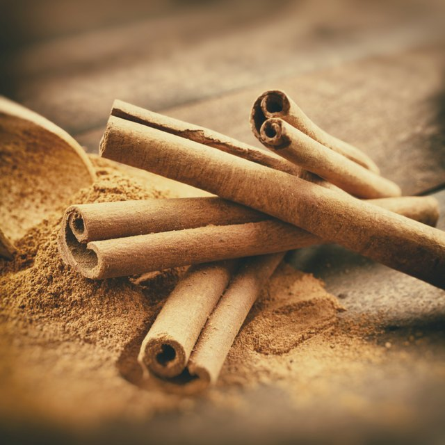 Vintage stylized photo of Cinnamon sticks and powder