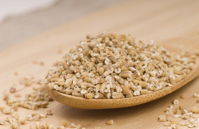 Steel cut oats on a wooden spoon