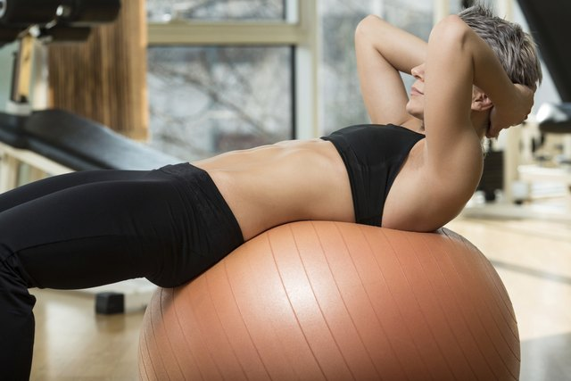 Attractive Woman Doing Sit-Ups With Exercise Ball