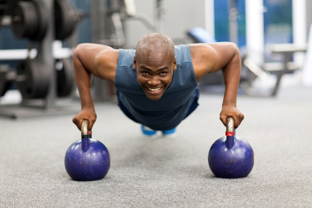 young african man doing push-ups exercise