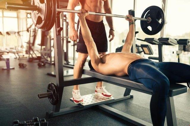 Muscular bodybuilder bench press workout