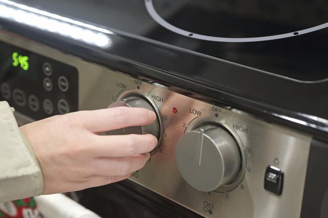 Woman using baking oven