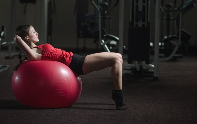 Young athletic girl in the gym
