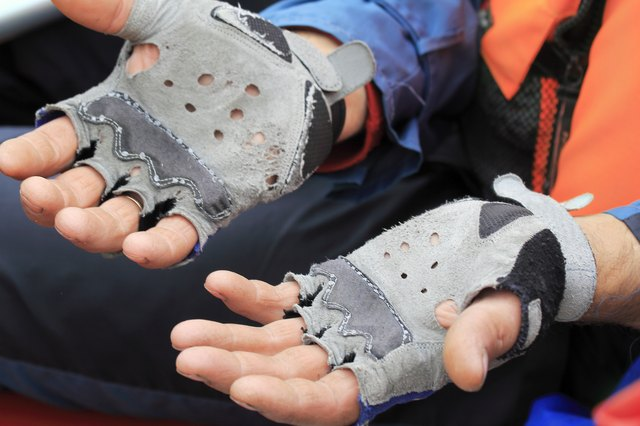 The hands of travelers in worn leather gloves