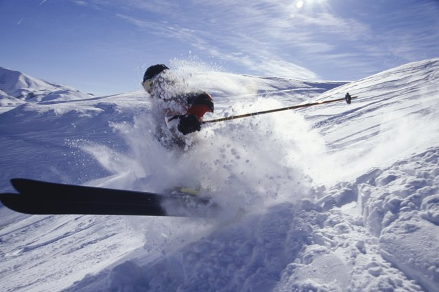 Skier landing in deep snow in mountains