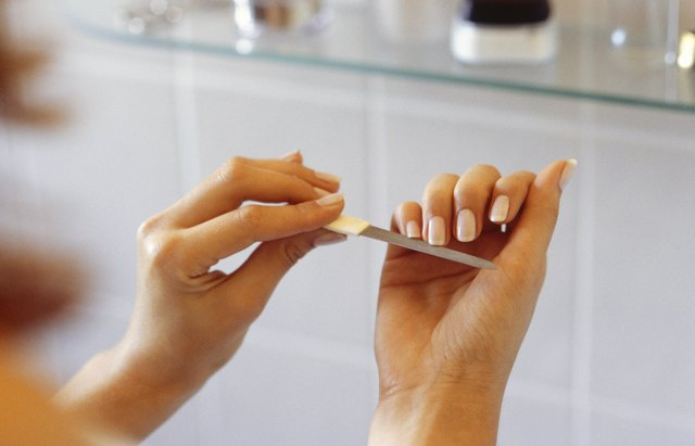 Woman filing nails with emery board, Close-up of hands, (Close-up)