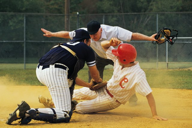 Man sliding into home plate