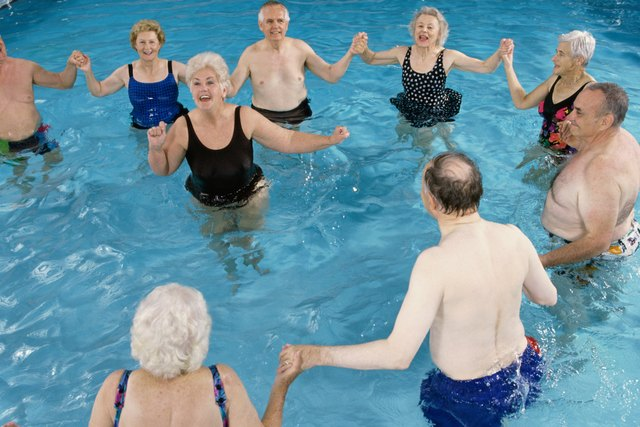 Group of senior people performing water aerobics in a swimming pool