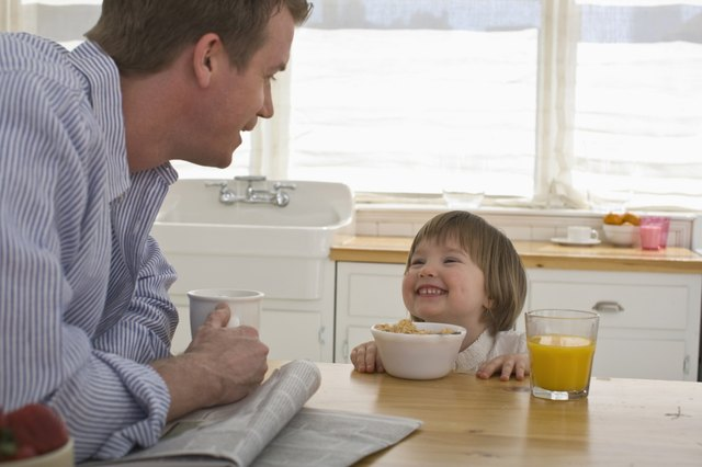 father and child at breakfast