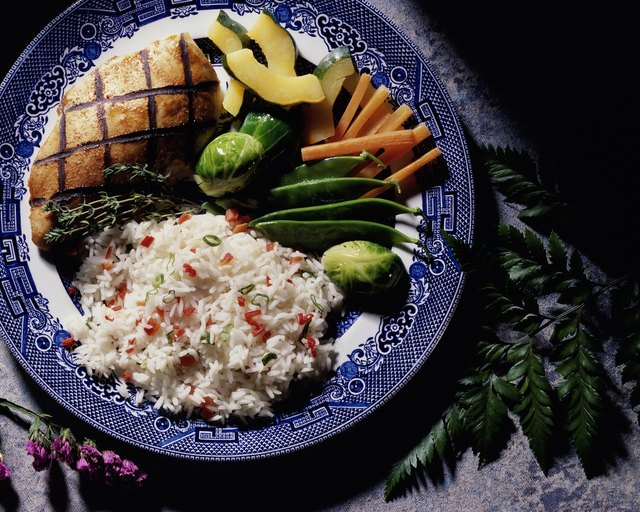 Grilled fish served with rice and vegetables
