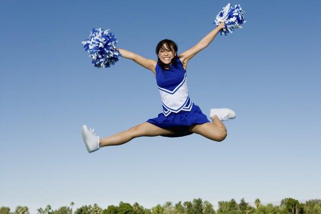 Jumping Cheerleader Performing Cheer in Mid-Air